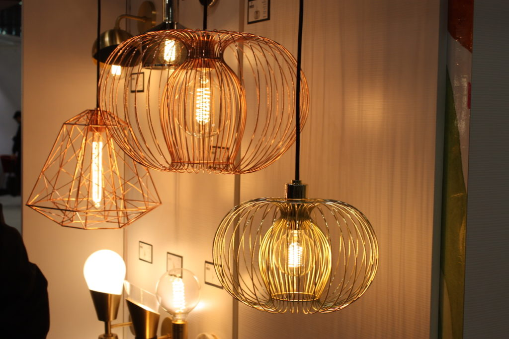 The rosy gold finish is particularly attractive on this style of light fixture.