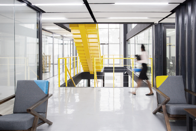The yellow of the staircase brightens up the whole building and gives it a cheerful vibe