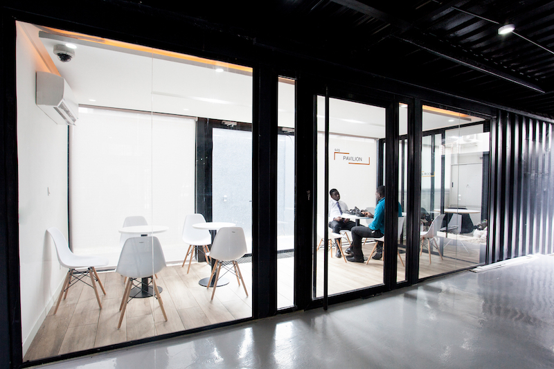 The glass walls let the light from the skylight enter the individual offices and meeting rooms