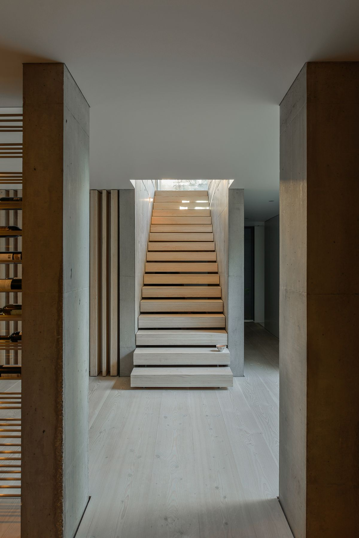 Linear and minimal, the stairway is an inconspicuous entry to the upstairs
