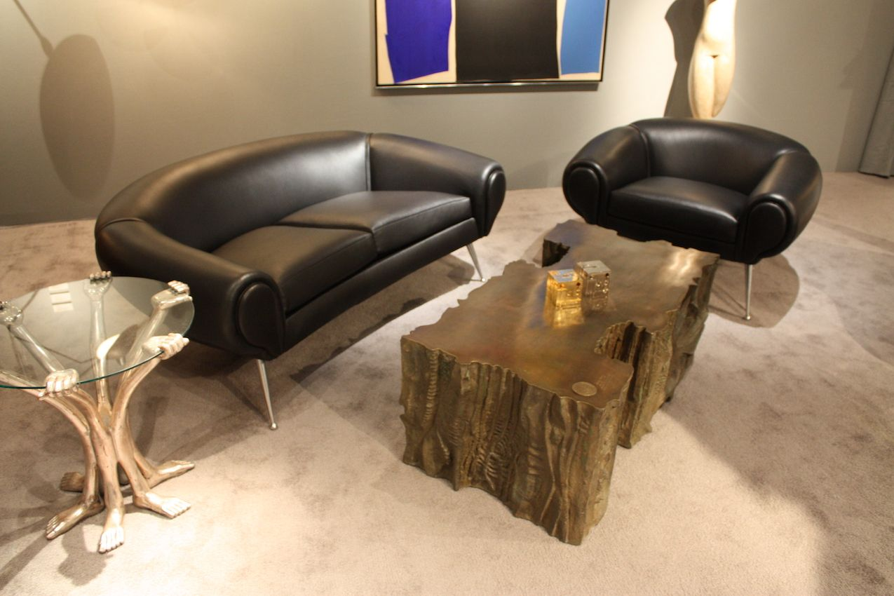 The rugged piece pairs nicely with the mid-century modern seating.