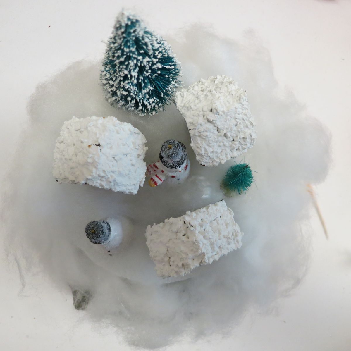 Make Gumball Machine Snow Globe Decor - hot glue trees