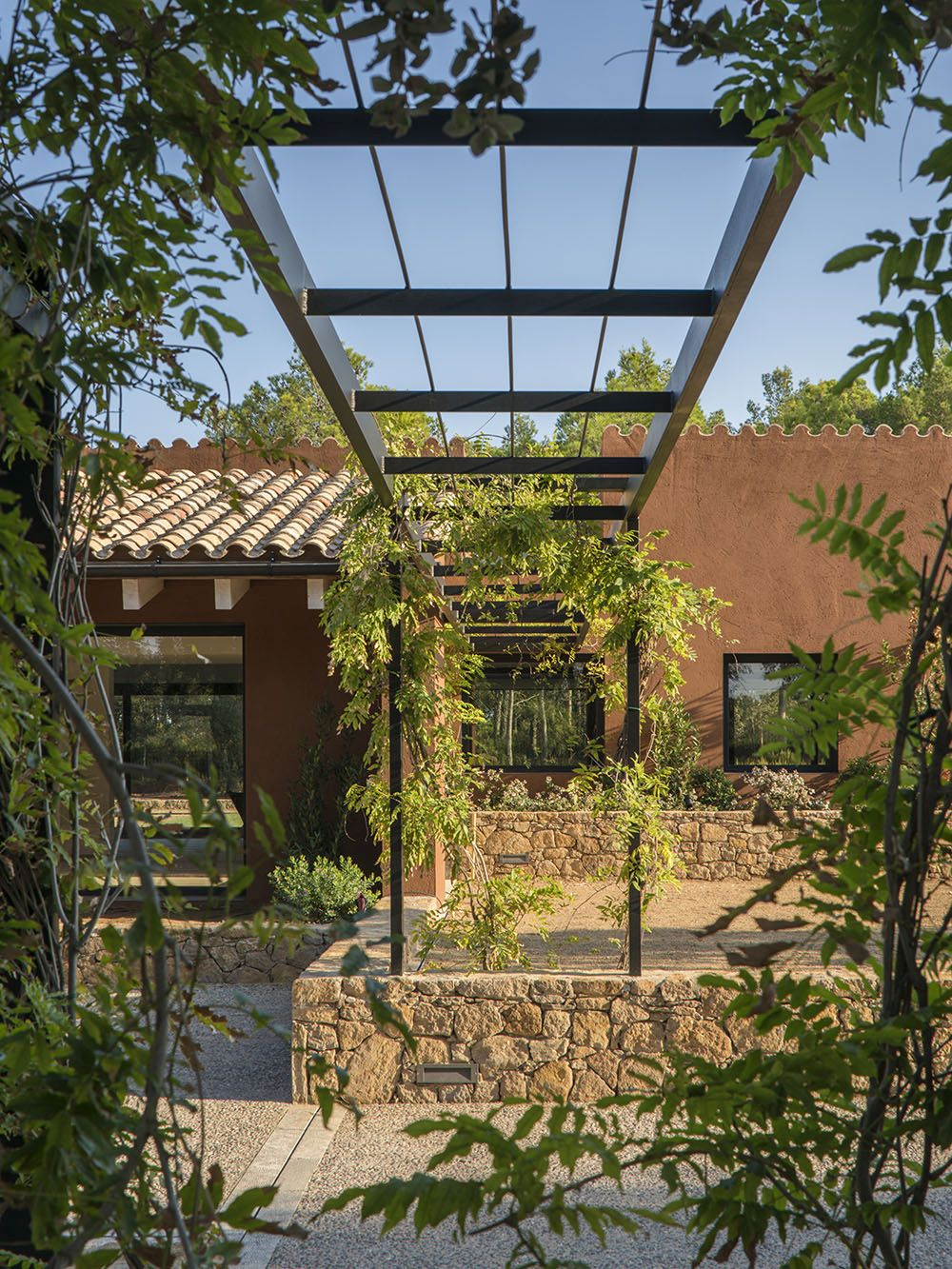 Modern arbors add plantings to the view right out the window