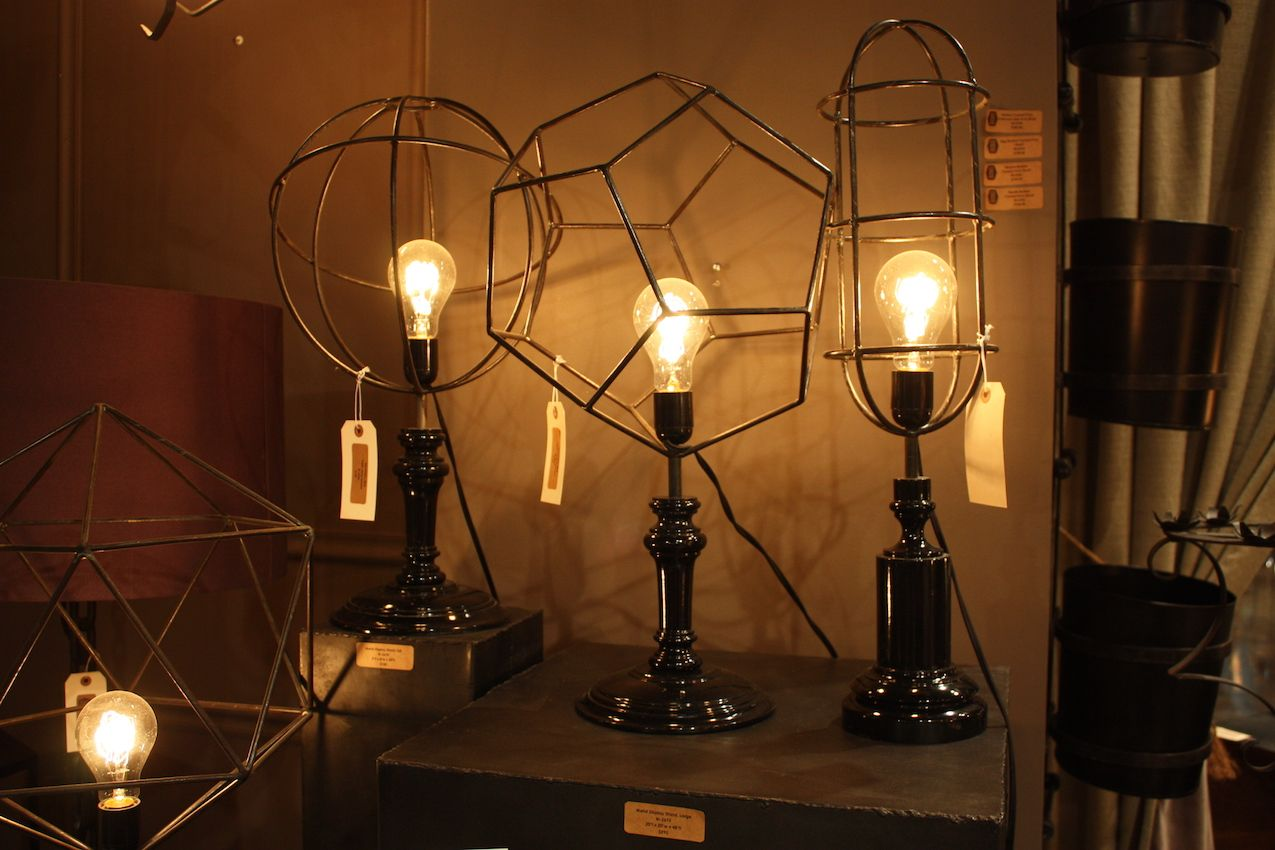 Palecek's black lamps use the cage element in place of traditional shades.