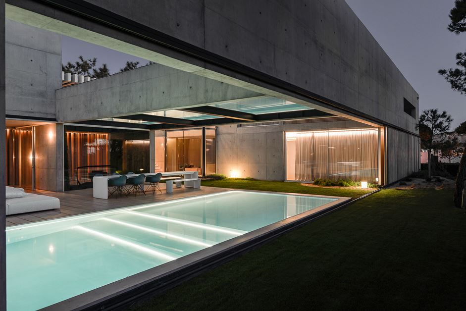 The nighttime poolscape is perfect for entertaining or for a relaxing swim on a hot night.