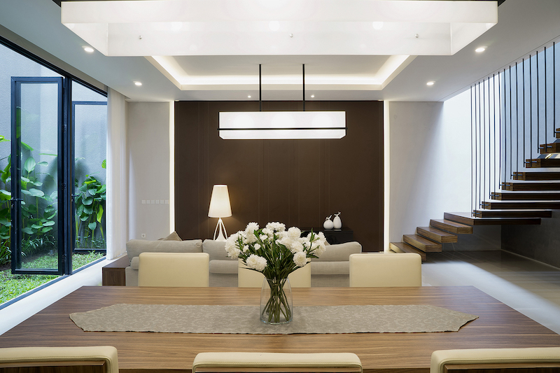 The living space, dining are and the kitchen share the same open plan, with matching light fixtures