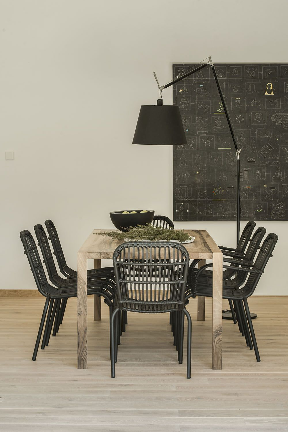 The artwork is also black and helps define the dining area.