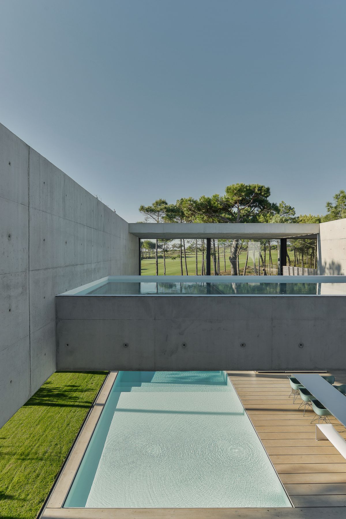The concrete walls and upper pool are spectacular design features.