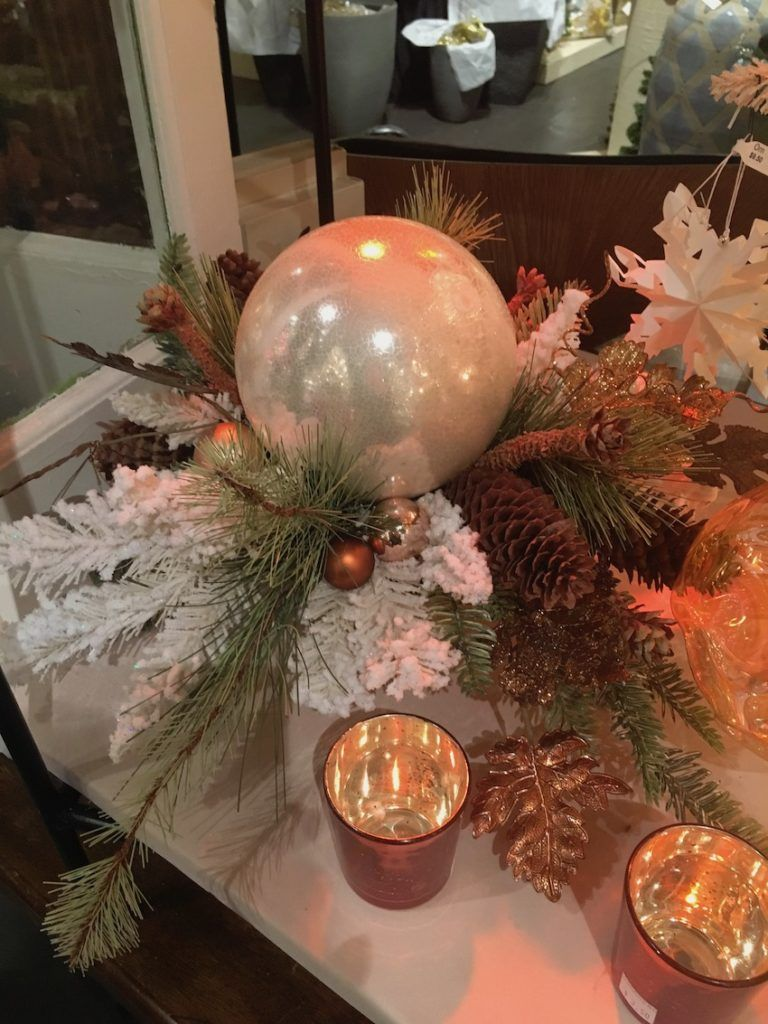 An unexpected or unusual dominant element makes a holiday centerpiece more contemporary.