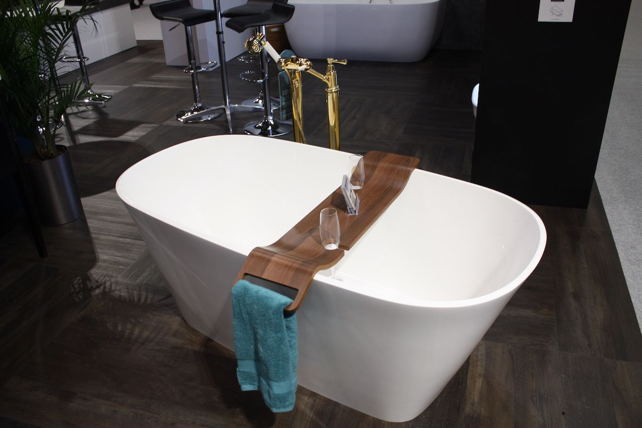 Vintage yet modern hardware and a luxe wood tray complete this tub set.