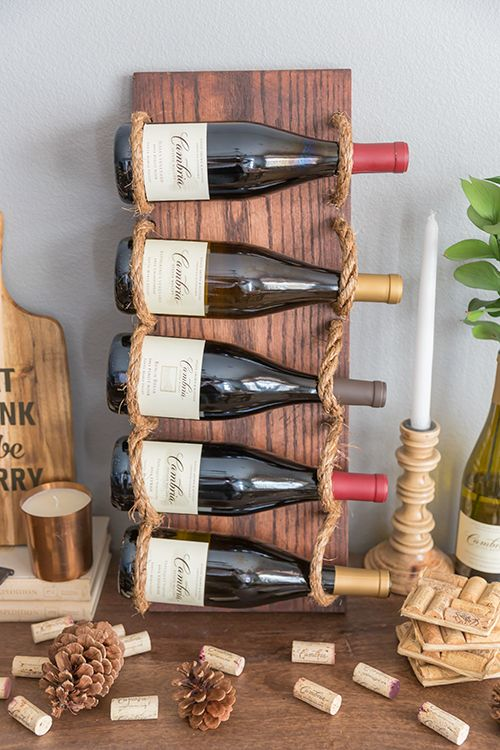 Simple wine rack made of wood and rope
