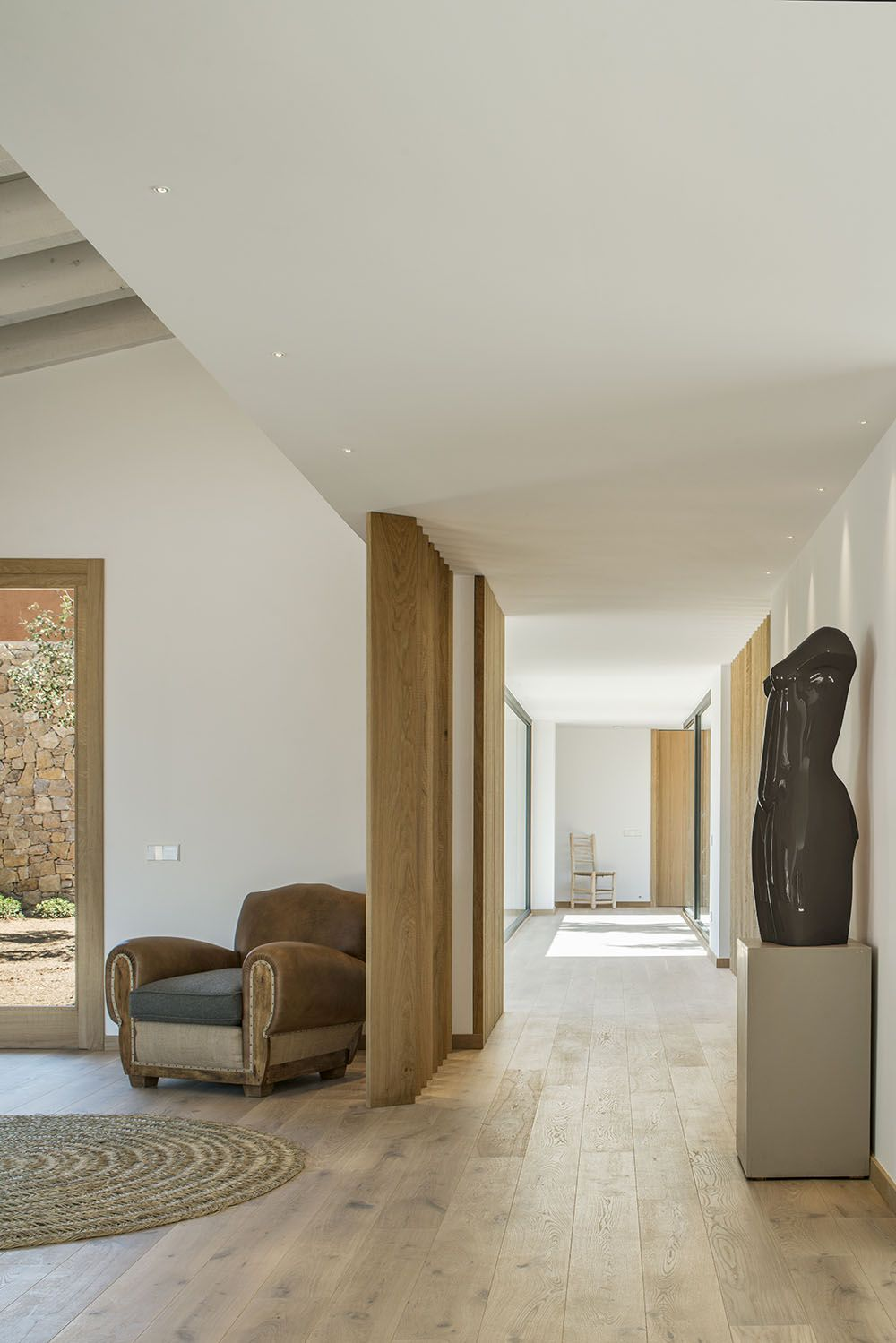 Wood floors throughout create a natural base for the minimalist design.
