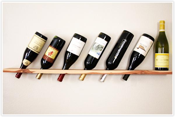 Minimalist wine rack that holds bottles upside down
