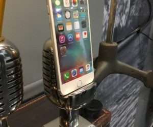 The microphone stand has an opening to run the charging cord up through the base.