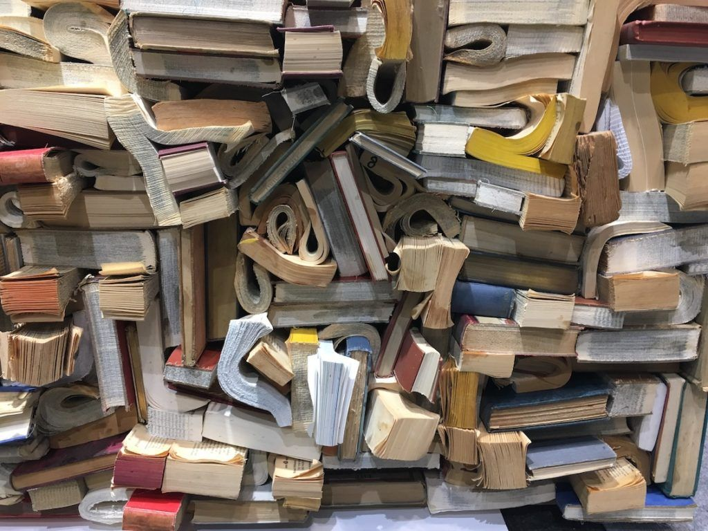 Carved, curled, trimmed and tucked, discarded books go into a fun texture-scape instead of the landfill.