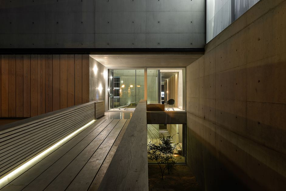 The walkway is illuminated by recessed lighting along the base.