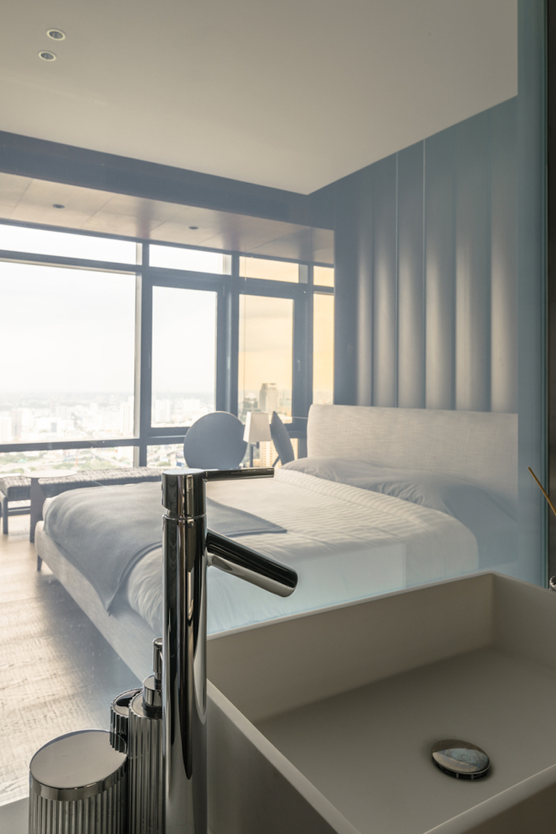 The second bedroom features a white-based decor meant to give it a spacious appearance