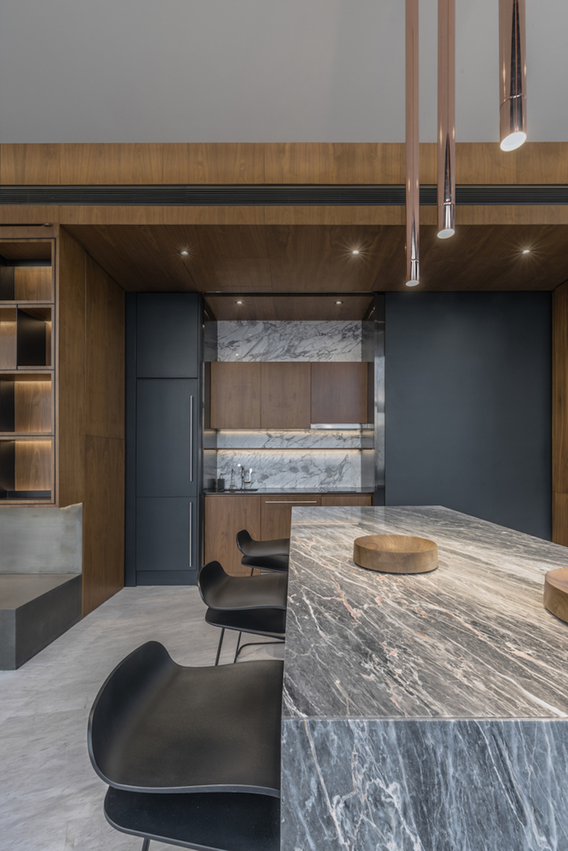 The kitchen is part of the open floor plan, being connected to the living/ lounge areas