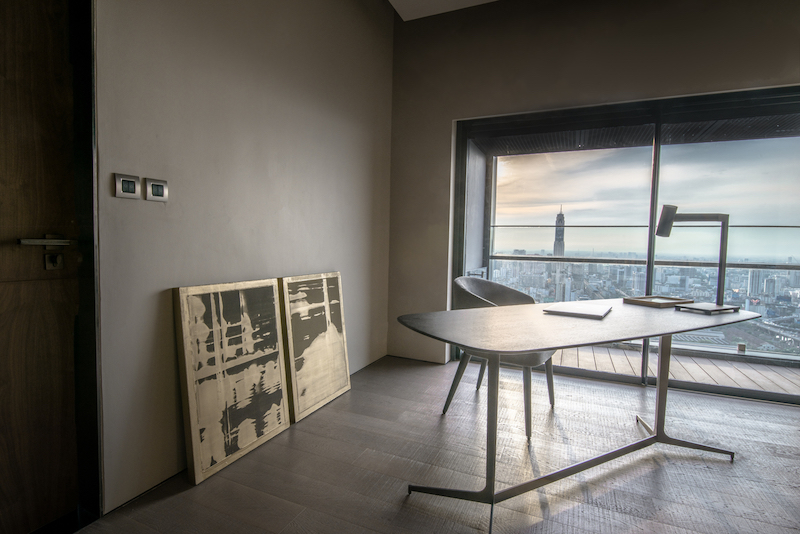 The master bedroom is spacious and has a study area with an adjacent balcony and panoramic views