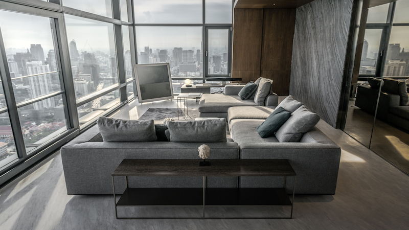 The living area has the most amazing views of the cityscape, featuring full-height windows