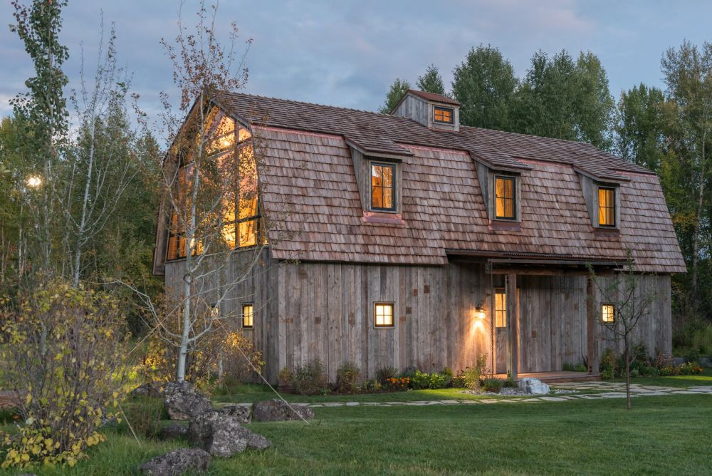 The exterior of the house is covered in reclaimed wood, hence the rustic look