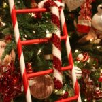 Fluffy, glittery giant candy canes hang on the bright ladders.