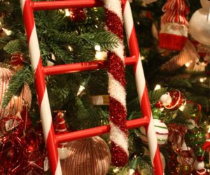 fluffy glittery giant candy canes hang on the bright ladders - Giant Candy Decorations Christmas