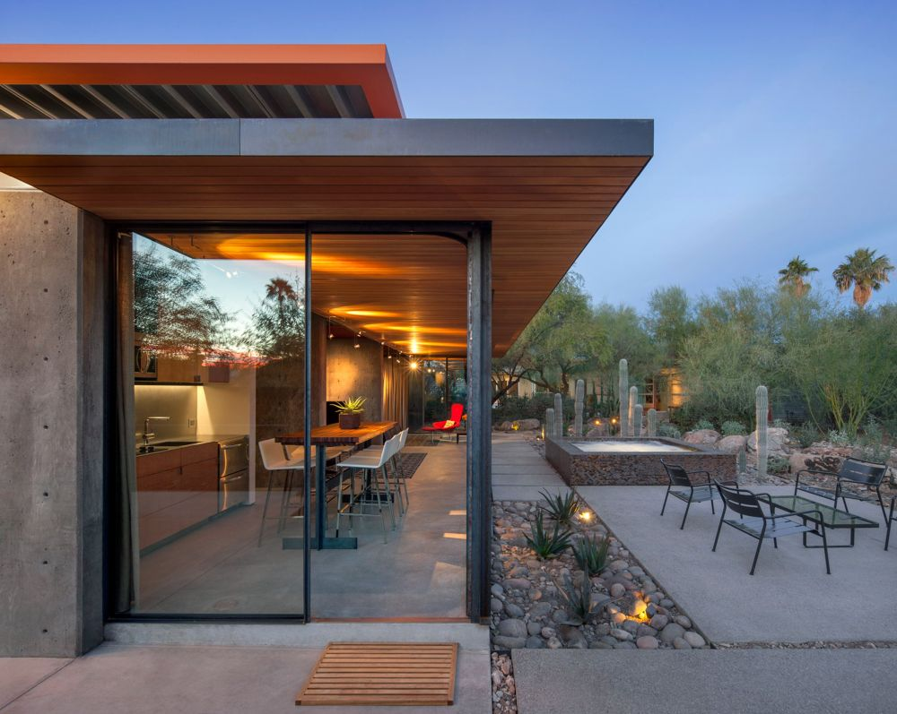 Sliding glass doors ensure a seamless connection between the interior and exterior spaces