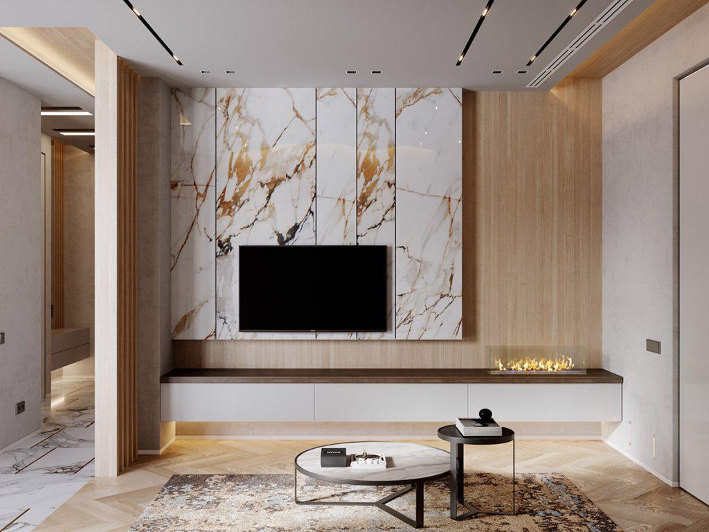 Considere decorar una losa de mármol como fondo alrededor del televisor montado