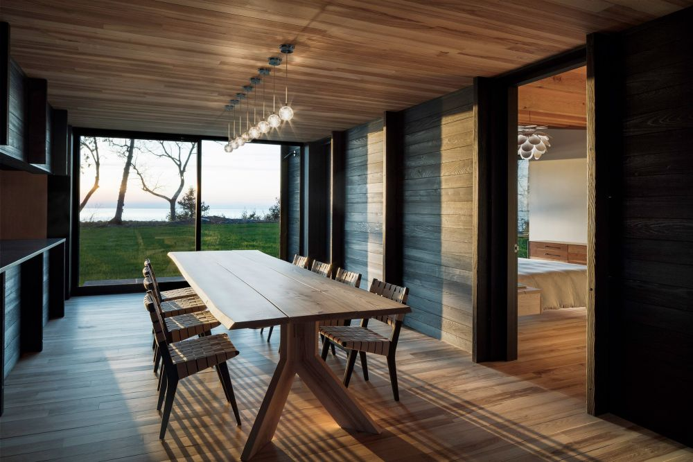 The dining room turns the view of the lake into its focal point of its decor
