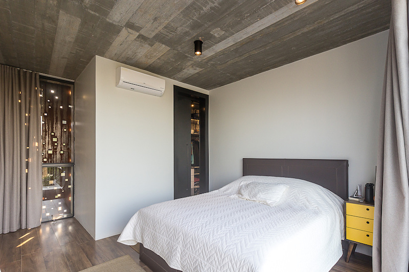 The bedrooms are designed to be simple and to feel inviting and comfortable