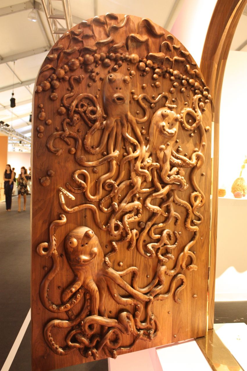 The interior side of the door is a tangle of octopus legs and profusion of bubbles.