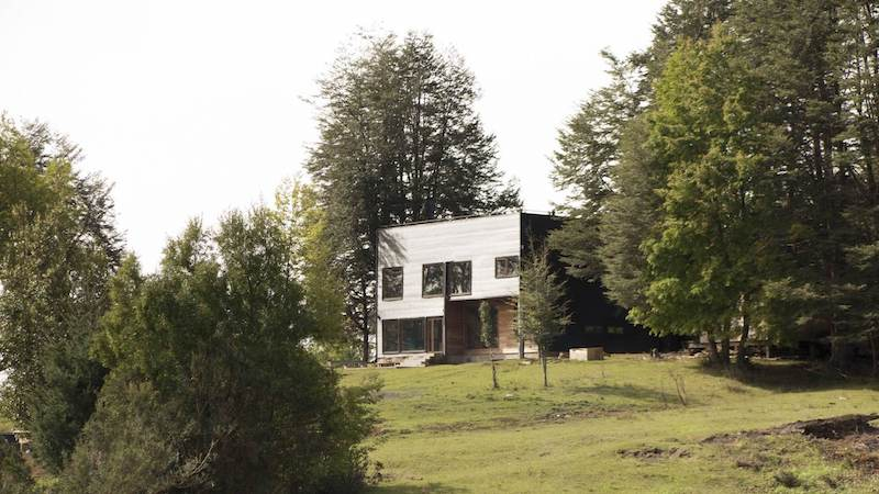 The house sits in a remote location, being surrounded by nature on all sides