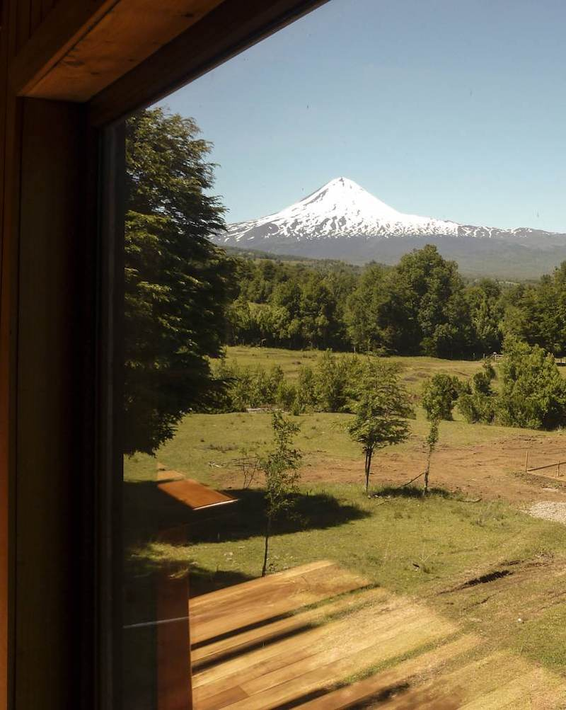 There's a view of a nearby volcano which can be admired from both inside and outside the house