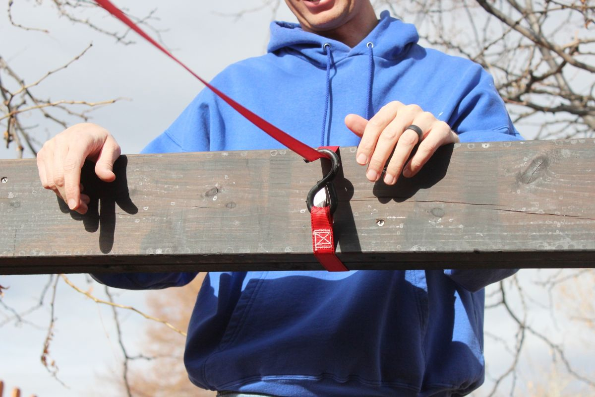 How to Install Pergola Rafters-The other end of the ratcheting strap will loop twice