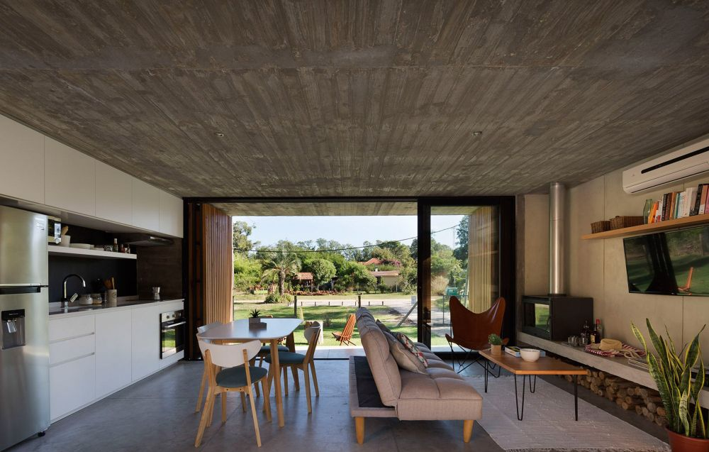 The interior is bright, open and surprisingly cozy for a house with concrete all around it