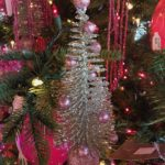 Mini glittery tree ornaments echo the overall color scheme and are amazingly cute!