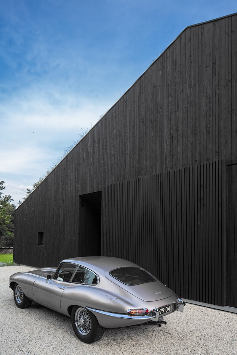 The blackened timber cladding helps both to make the house stand and blend in with its surroundings