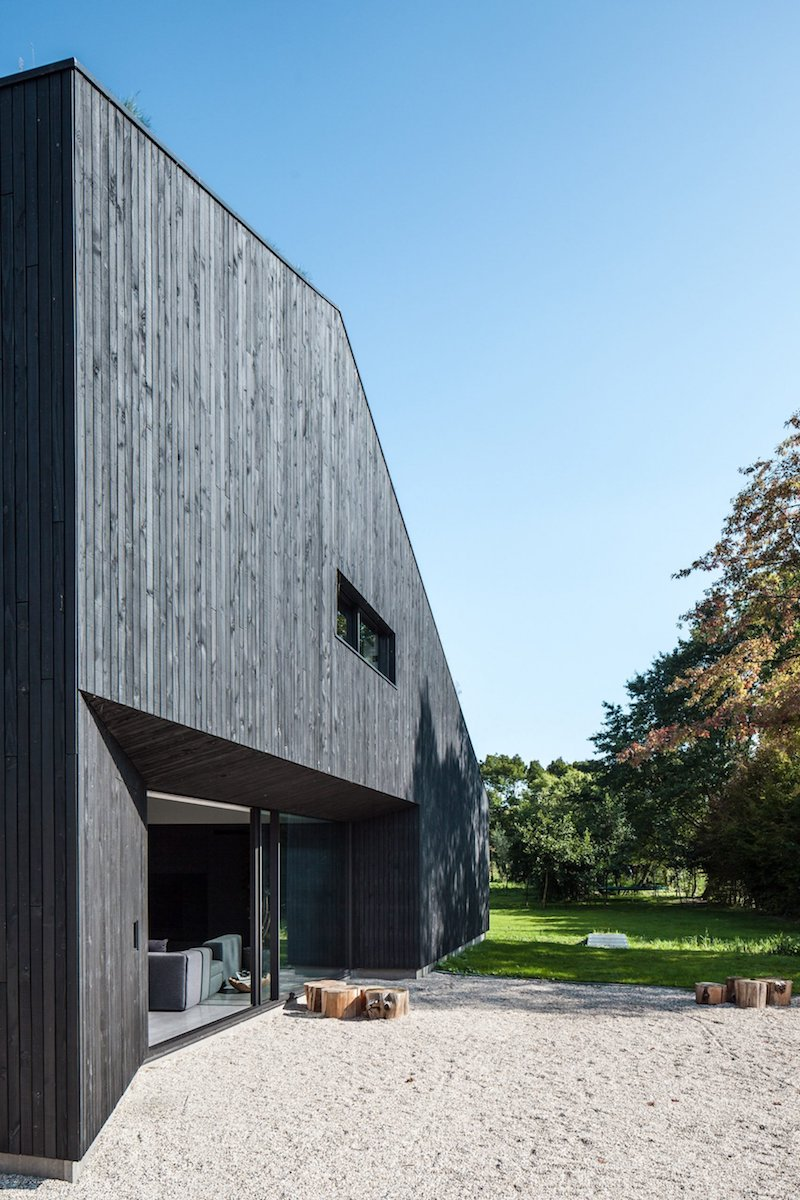 The overall shape of the house is similar to that of a traditional barn with a few modern twists