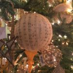 Lots of pretty , shiny metallic ornaments and a good number of one special ornament can create a subtle themed tree.