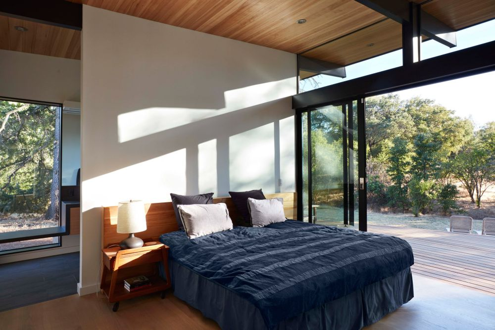 The master bedroom has sliding glass doors which connect it to a large terrace