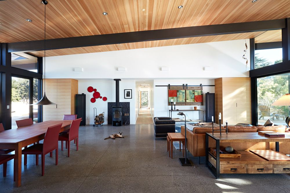 Concrete flooring and wooden ceilings complement each other while the furnishings are kept simple