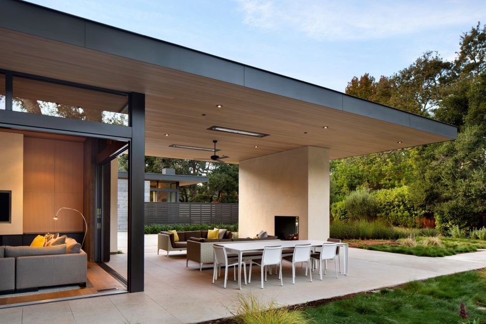 The outdoor spaces are expansive and serve as buffer zones between the house and the garden