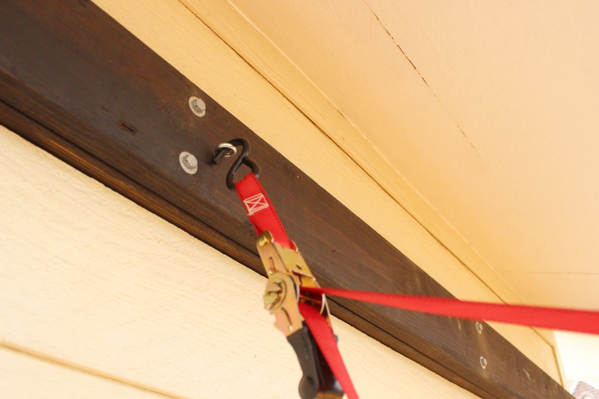 Once the screw eye is fully secure into the center of the wall-mounted frame