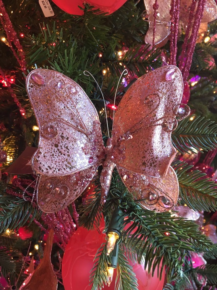 Pink bejeweled butterflies add another feminine element to the tree.