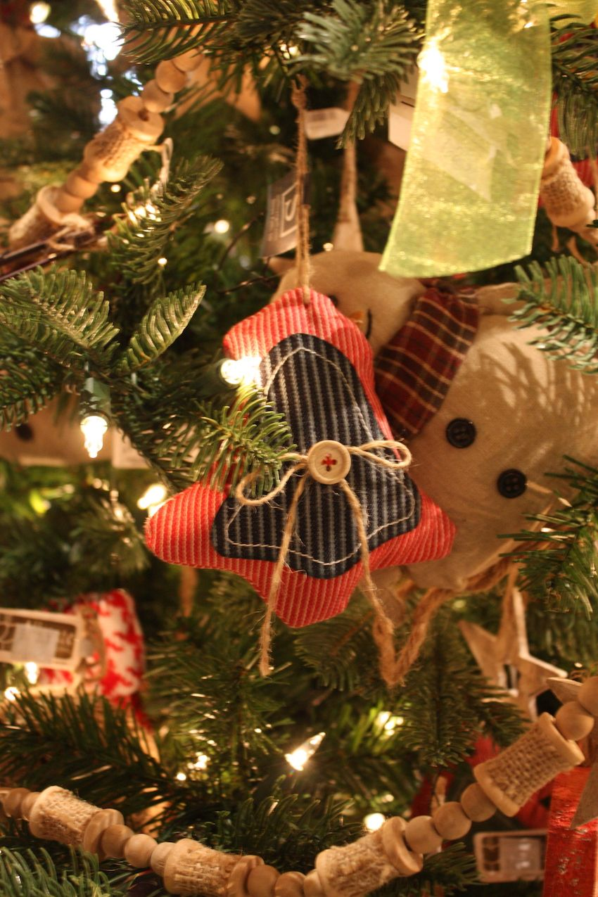 Simple stuffed ornaments, embellished with twine and a single button, are rustic.