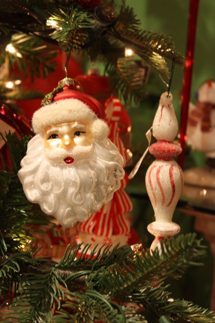 Santa ornaments are a must on a fun red-themed tree.