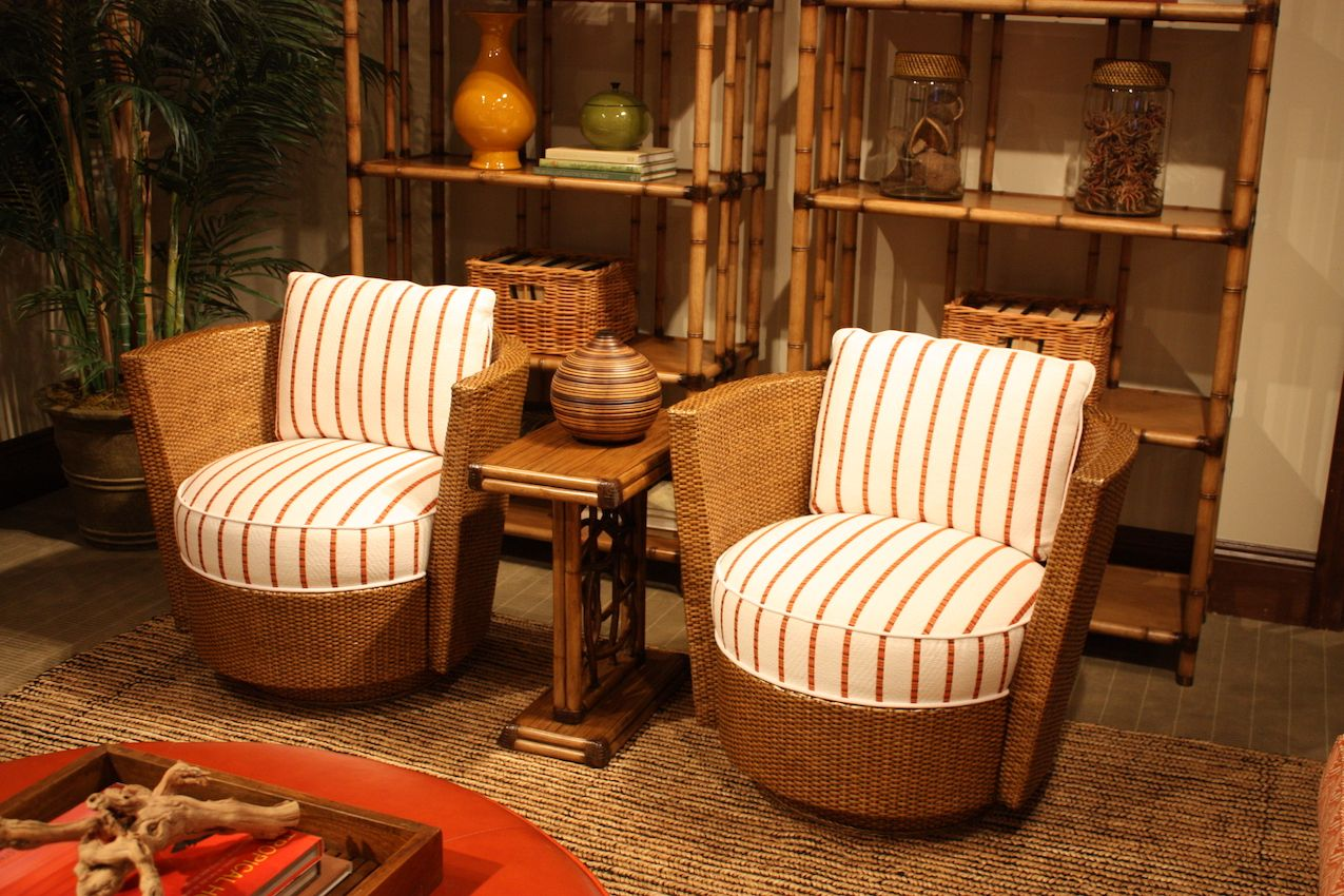 Thin, burnt orange striped cushions pair well with the casual wicker frame.