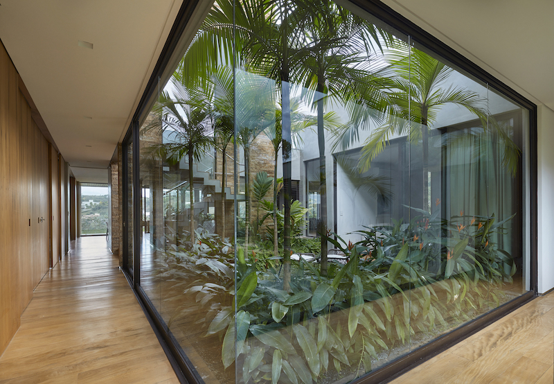 The garden is like an interior courtyard framed by glass walls and can be seen from several spaces