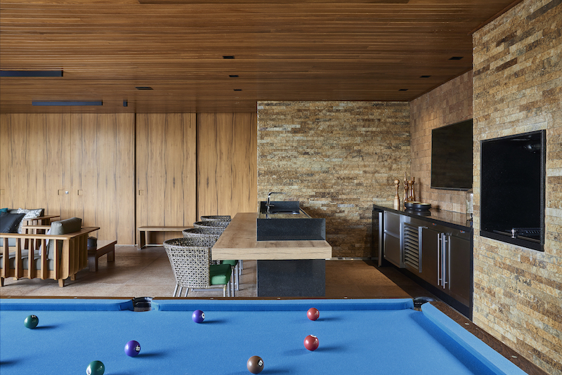 There are numerous entertainment spaces such a home theater or this relaxation area which has a pool table
